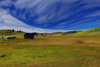 blue sky over farmland