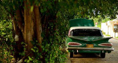 green retro car under tree