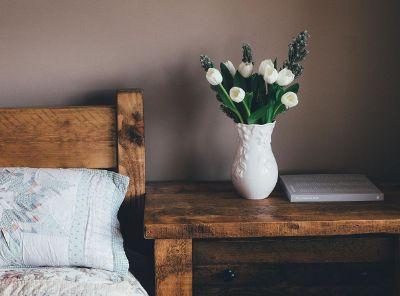 white tulips in a white vase