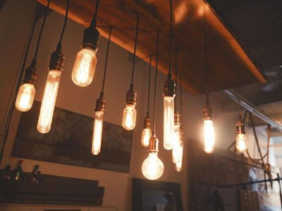 incandescent bulbs hanging from wood