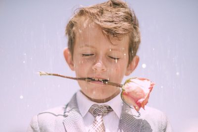 boy in suit with a rose