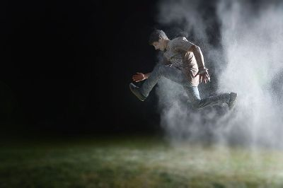 boy jumping in dusty air
