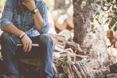 man sitting on the wood