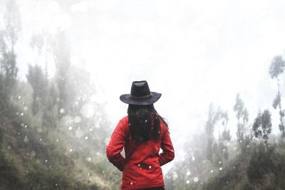 person in red under snow fall