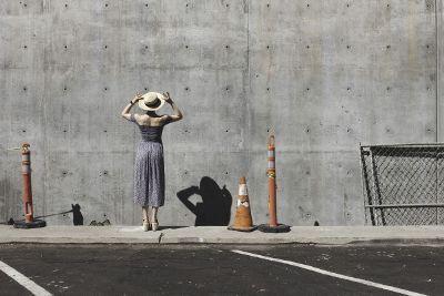 woman adjusting hat