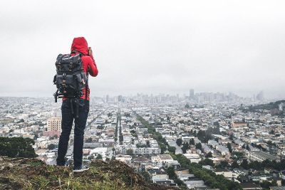 hiker takes city photography