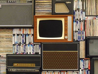 vintage shelf arrangement with tv and books and tapes