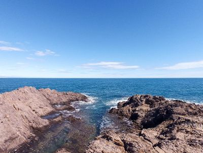 ocean with blue sky and rocks