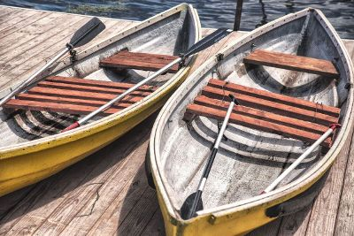 two rowboats on a dock