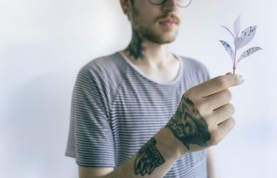 man holding leaf