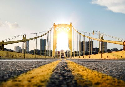 on a bridge facing sun