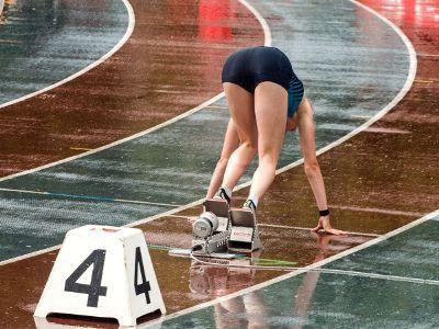 track runner in the rain