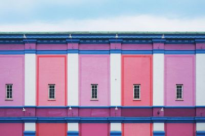 colorful pink building with windows