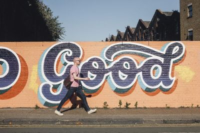 man walking in front of good