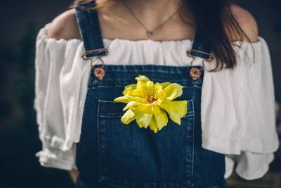 girl with flower in pocket