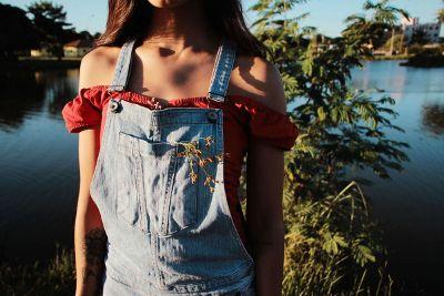 skinny girl in overalls