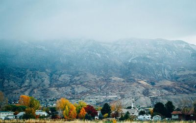 autumn village in front of mountains