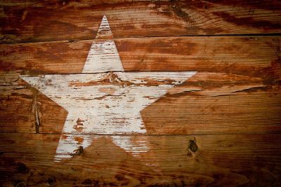 fading painted star on wood