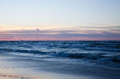 ocean beach with a sunset