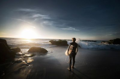 surfer contemplating paddling out