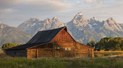 mountainside view behind a barn