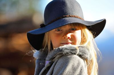little girl with blue hat
