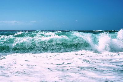blue and white waves crashing