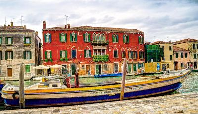 boat near colorful buildings