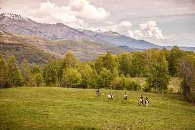 horseback riding in a valley