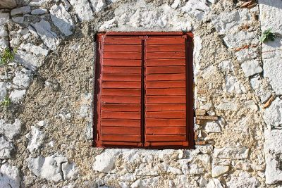shuttered window infused in rock
