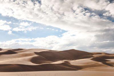 barren desert and cloudy sky