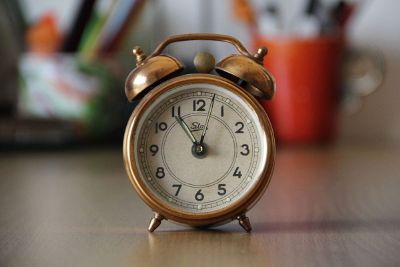 old fashioned alarm clock on desk