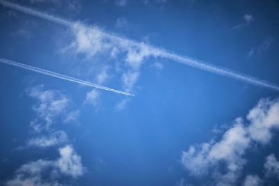 contrails in blue sky
