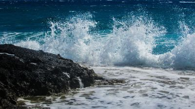 beautiful wave splashing against a rock