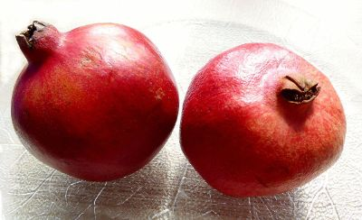 two pomegranates in a plate
