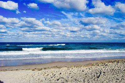blue sky over waves
