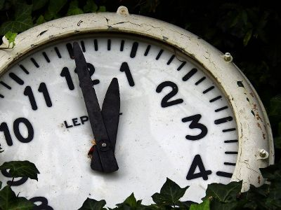 weathered ivy covered clock