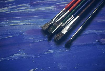 paint brushes on blue table