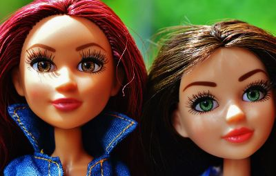 two female barbie type dolls
