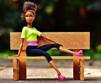black barbie on a bench