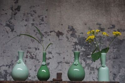 green vases with flowers