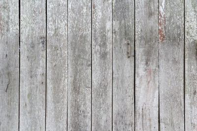 a weathered grayed wooden fence