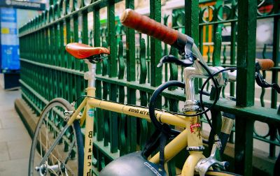 bike parked against fence