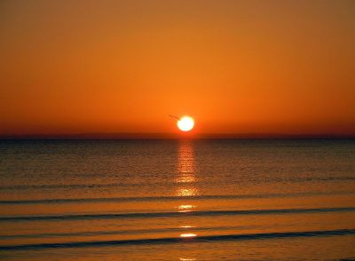 setting sun over ocean