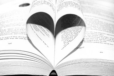 book pages curled into heart shape