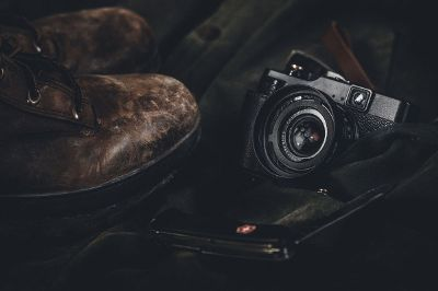 still life with boots and camera