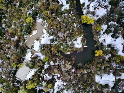 aeriel view of mansion in snow
