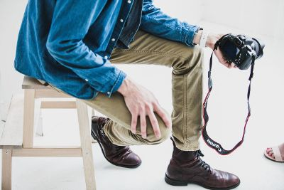 photographer with hand on knee