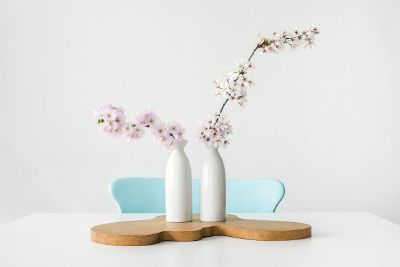 milk jug flowers on a table