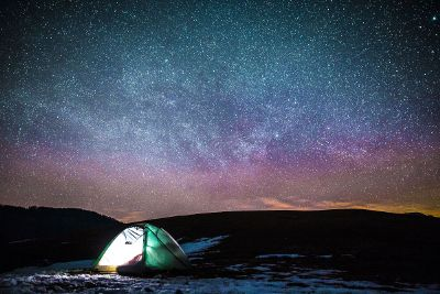 tent camping under beautiful night sky